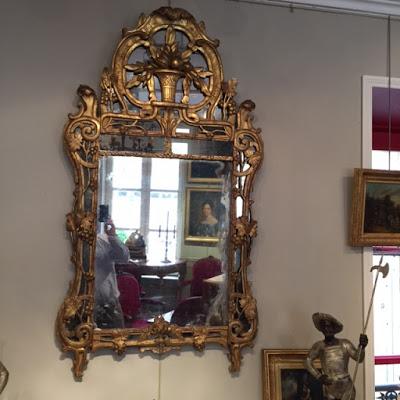 Glace à par-closes en bois doré d'époque Louis XV