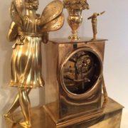 Pendule en bronze doré amour et jardin