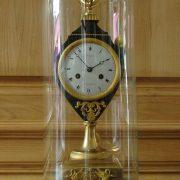 Pendule en bronze doré et tole patinée