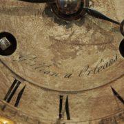 Pendule d'époque Restauration représentant une femme pensive