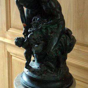 Statue en terre cuite verdie d'après Clodion