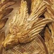 Glace d'époque Louis XVI en bois sculpté et doré