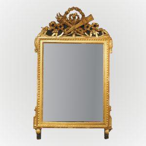 Glace d'époque Louis XVI en bois doré