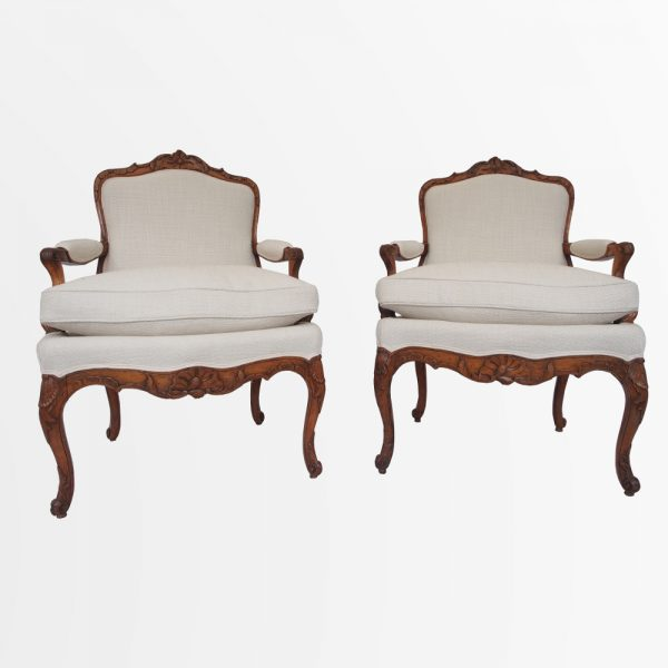 Paire de fauteuils a coussins d'époque Louis XV en bois naturel