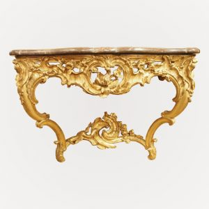 Console d'époque Régence, en bois richement sculpté et doré