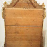 Glace d'époque Louis XVI en bois sculpté et doré dans sa dorure d'origine