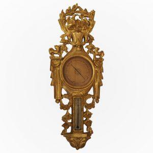 Baromètre -thermomètre d'époque Louis XVI en bois sculpté et doré